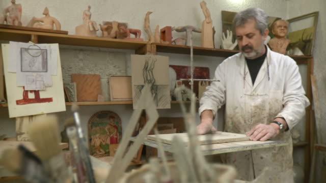 HD DOLLY: Sculpture Artist Preparing For Work video