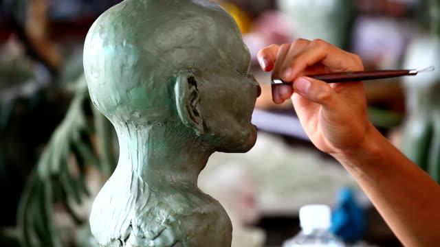 sculpture head made video