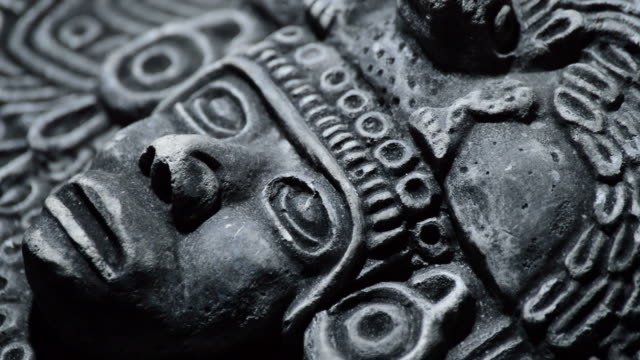 sculpture in stone of face of mesoamerican ancient art south american - coloniale video stock e b–roll