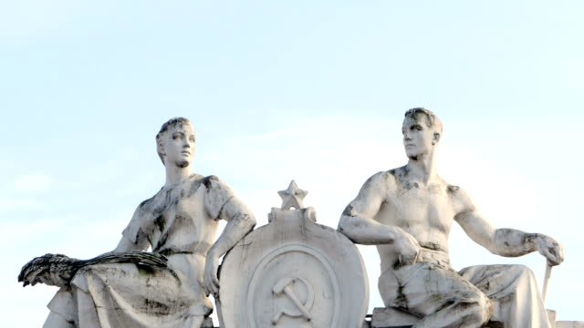 sculpture worker and woman collective farmer Soviet art St. Petersburg, Russia, 20 March 2018, sculpture worker and woman collective farmer, Soviet neoclassicism in  architecture neoclassical architecture stock videos & royalty-free footage