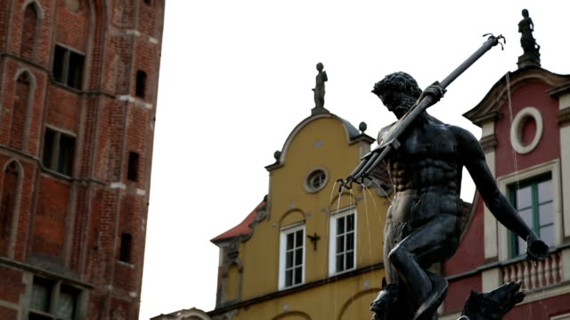 Sculptures adorning fountain in city, statue of Poseidon holding trident, Gdansk video