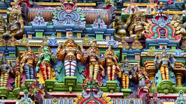 sculptures on hindu temple gopura (tower). menakshi temple, madurai, tamil nadu, india - tempio video stock e b–roll