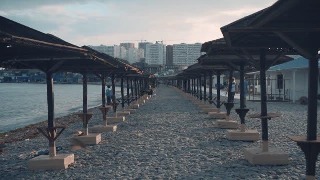 Sea and beach with wooden umbrellas. Sea background. Sea and beach wooden umbrellas.