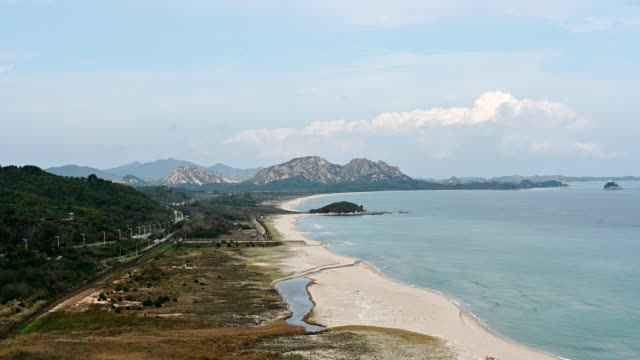 Sea and earth from Goseong unification observatory of peaceful boundary between North Korea and South Korea Scenery of sea and earth from Goseong unification observatory of peaceful boundary between North Korea and South Korea south korea stock videos & royalty-free footage