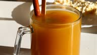 istock Sea buckthorn tea in a glass cup with a cinnamon stick. 1305770824