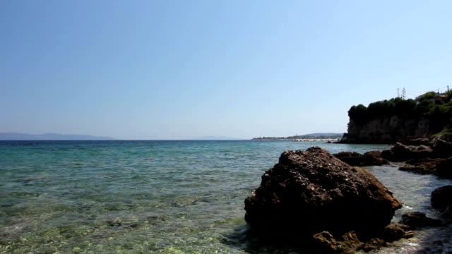 Sea erosion of rugged cliffs on rocky coastline video