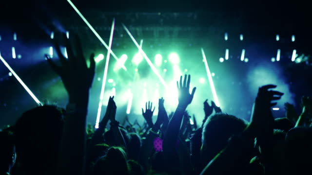 vídeos de stock e filmes b-roll de sea of hands at a concert party. - membro