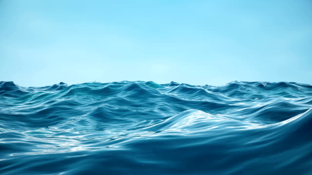 Sea or ocean, waves close-up view. Blue waves sea water. Blue crystal clear water. One can see the sandy seabed. Sea wave low angle view. 3D 4K animation