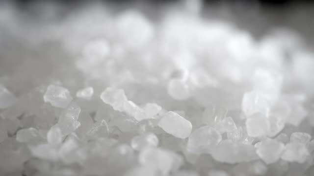 sea salt crystals being poured. - соль минерал стоковые видео и кадры b-roll