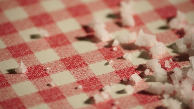 Sea salt on a checkered kitchen table with red and white video