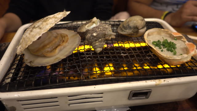 sea shell and clam shell BBQ grilled on fire video