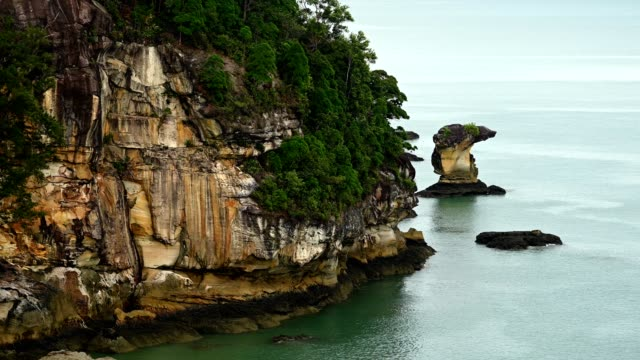 Sea stacks of Bako National Park against sky