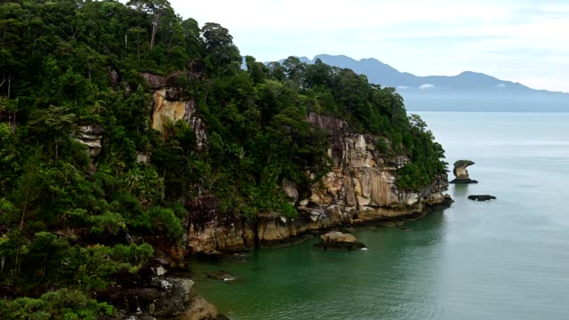 Sea stacks of Bako National Park against sky