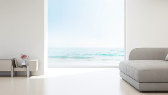 Sea view living room of luxury summer beach house with glass window and wooden floor. Empty white concrete wall background in vacation home or holiday villa. 3d rendering of hotel interior. living room stock videos & royalty-free footage