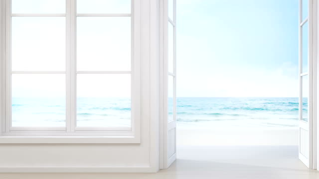 Sea view room with window and door in modern beach house, Luxury white interior of summer home video
