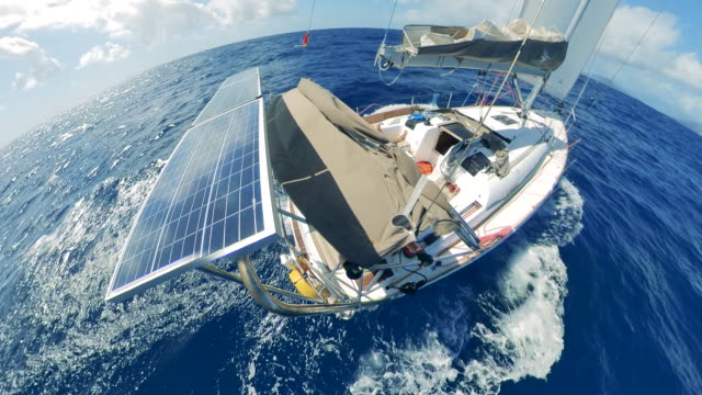 Sea waters with a sailboat on solar batteries Sea waters with a sailboat on solar batteries. 4K recreational boat stock videos & royalty-free footage