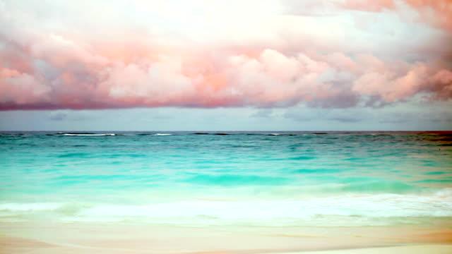 multi exposure slow motion - sea wave, cuba - pink sunrise bildbanksvideor och videomaterial från bakom kulisserna