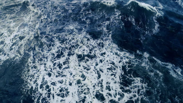 Sea waves. Aerial view Ocean waves cresting on rocky shore. Aerial view the four elements stock videos & royalty-free footage