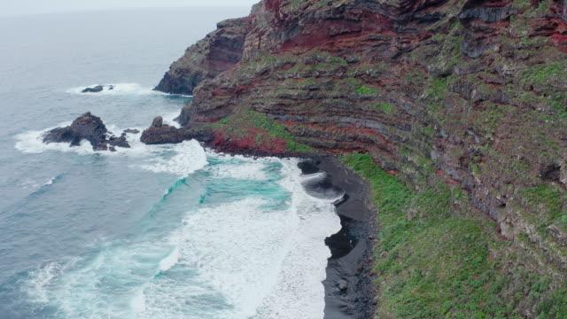 AERIAL MS Sea waves and rocky coast / Canary Islands, Spain