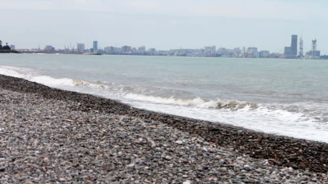 Sea waves beat on stony shore on the embankment of the Georgian city of the resort of Batumi video