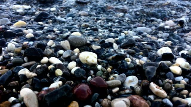 Sea waves on pebbles video