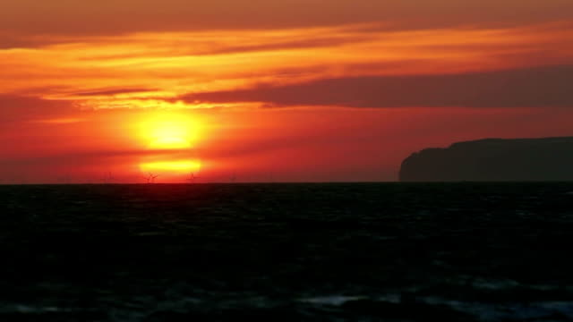Sea Wind Farm At Sunrise