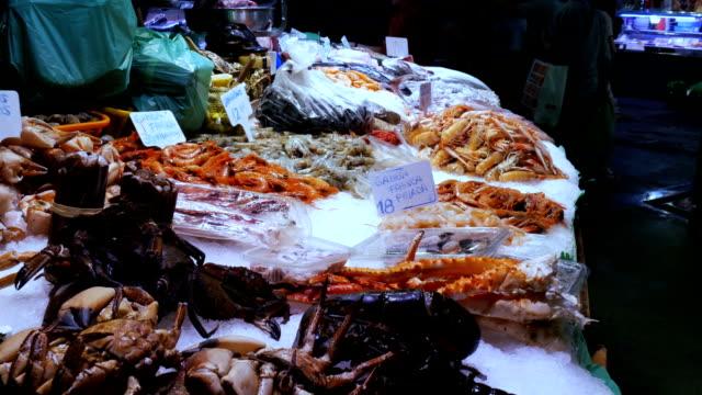 Seafood crabs lobster squid shrimps crayfish oyster mussels seashells in fish market La Boqueria Spain, Barcelona video