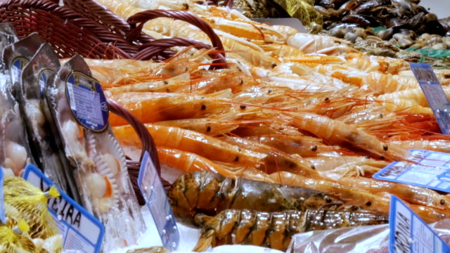 Seafood moving shrimps great lobsters and crabs on the counter market,Seafood in the market La Boqueria in Barcelona video