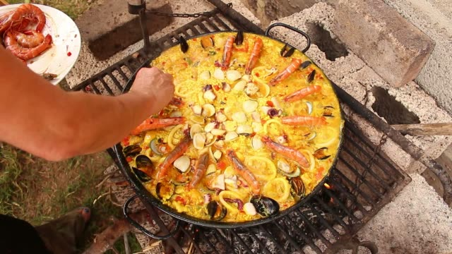 seafood paella in the fry pan - spanish food stock videos and b-roll footage