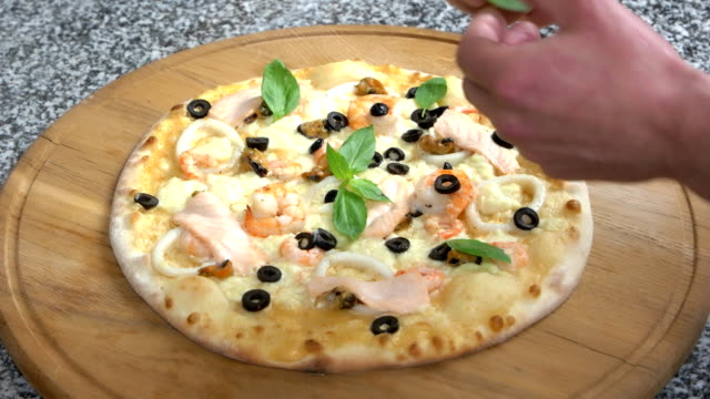 seafood pizza with basil leaves. - seafood stock videos and b-roll footage