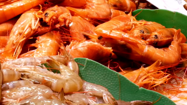 Seafood shrimps crawfish crabs on the counter market,Seafood in the market La Boqueria in Barcelona close up view video