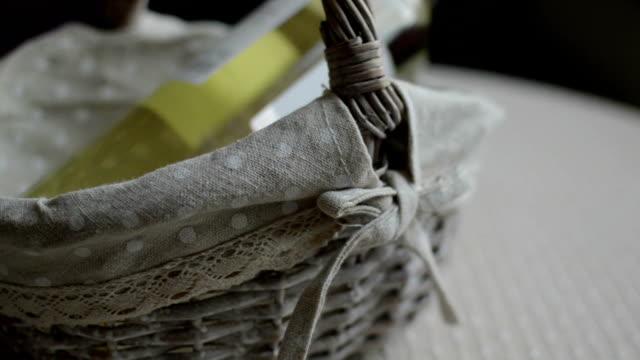 Sealed wine bottle in wicker basket video