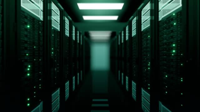 smidig flygresa genom den server rack gröna färg i datacenter dof oskärpa. vackra loopas 3d-animering med fladdrande dator ljus. modern elektronik teknik koncept. - server room bildbanksvideor och videomaterial från bakom kulisserna
