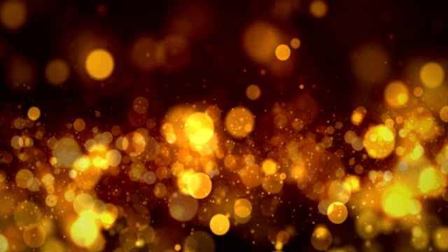 seamless golden particles bokeh abstract, 4k video loop - christmas movie video stock e b–roll