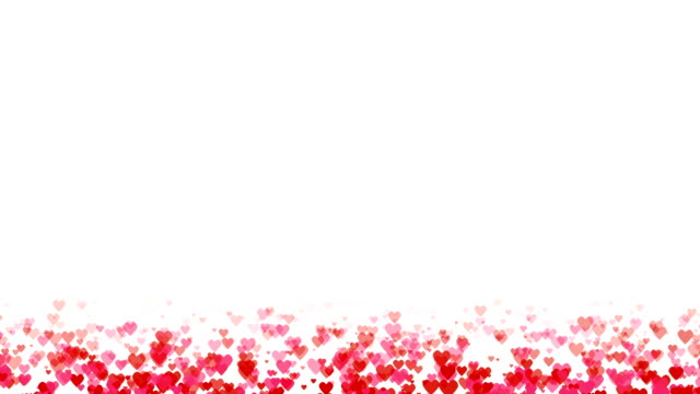 Seamless loop background with pink and red colored confetti hearts for valentine time or mothers day.