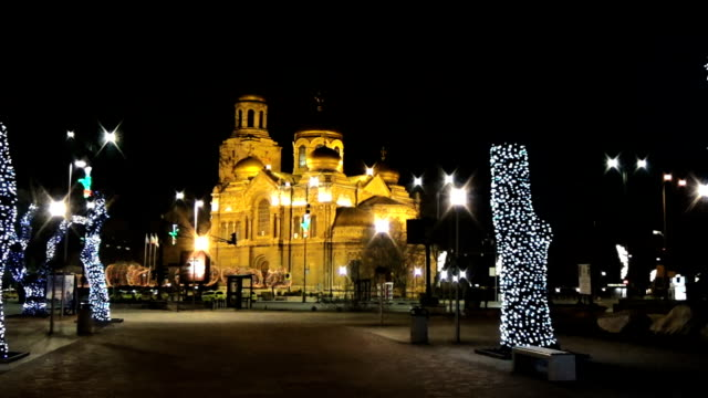 Seamless loop motion background long shot at Varna Cathedral at night with video