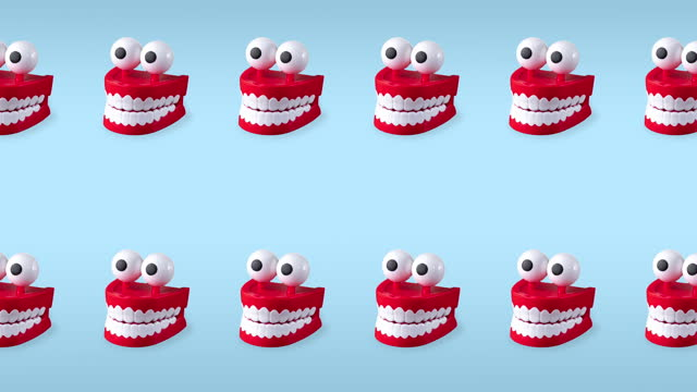 seamless looping animation of two rows chattering teeth toys with big eyes on a blue pastel background. plastic red mouths with white fangs is a concept of oral hygiene and healthy teeth, copy space