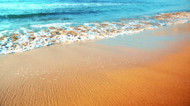 Seamless Looping Shot of Sand Beach, Gentle Turquoise Waves video