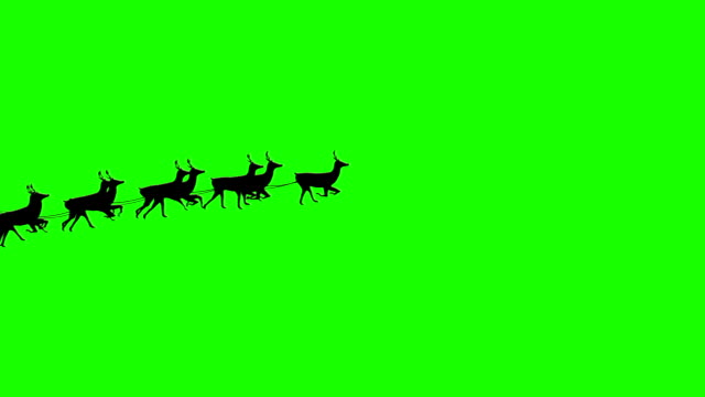 seamless santa sleigh dropping gifts on green background - reindeer stock videos and b-roll footage