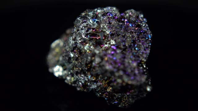 Seamlessly rotating a metallic mineral (Silicon Carbide) in front of black background Seamlessly rotating a metallic mineral (Silicon Carbide) in front of black background boulder rock stock videos & royalty-free footage