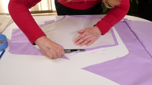 Seamstress Cutting Clothes Pattern video