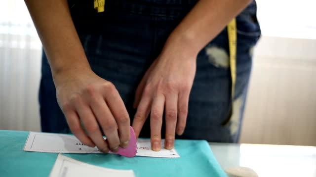 Seamstress woman preparing material