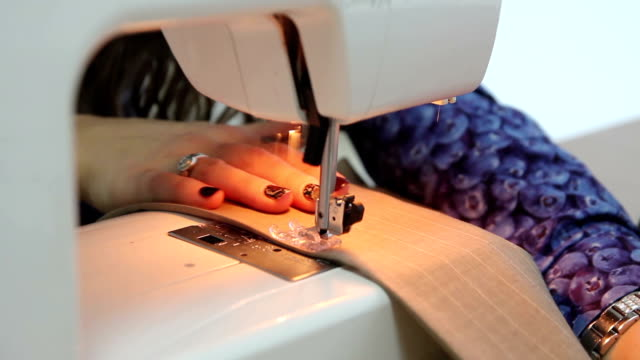 seamstress works on the sewing machine video