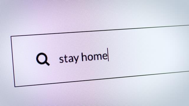 """vídeos y material grabado en eventos de stock de motor de búsqueda sobre coronavirus. escribir """"quedarse en casa"""" en la barra de búsqueda. - stay home"""