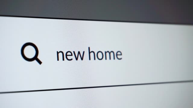 """Search for """"new home"""" word on the internet Close-up of search """"new home"""" word on computer screen. HD video. house rental stock videos & royalty-free footage"""