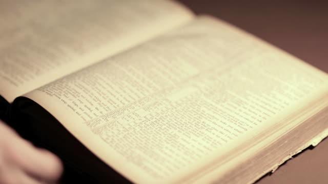 Searching Through a Vintage Bible (HD,NTSC) video
