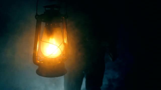 Searching with kerosene lamp Searching with kerosene lamp lantern stock videos & royalty-free footage