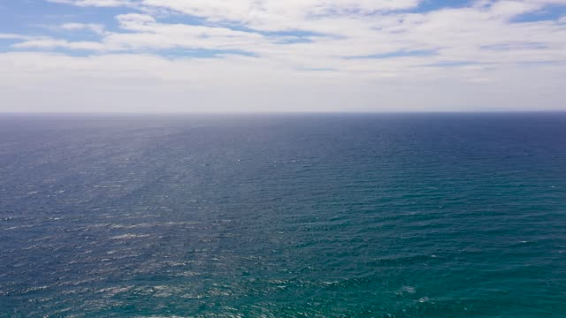 Seascape, aerial view. Blue sea and sky with clouds