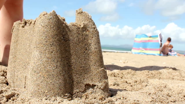 Seaside Fun Children playing on the coast. castle stock videos & royalty-free footage