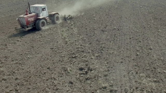Seasonal agricultural work in the field Plowing the land before planting harrow agricultural equipment stock videos & royalty-free footage